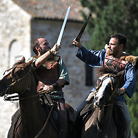 Aquileia, Italy - 17 June 2018: Celtic knights fight on horses during Tempora in Aquileia, ancient Roman historical re-enactment