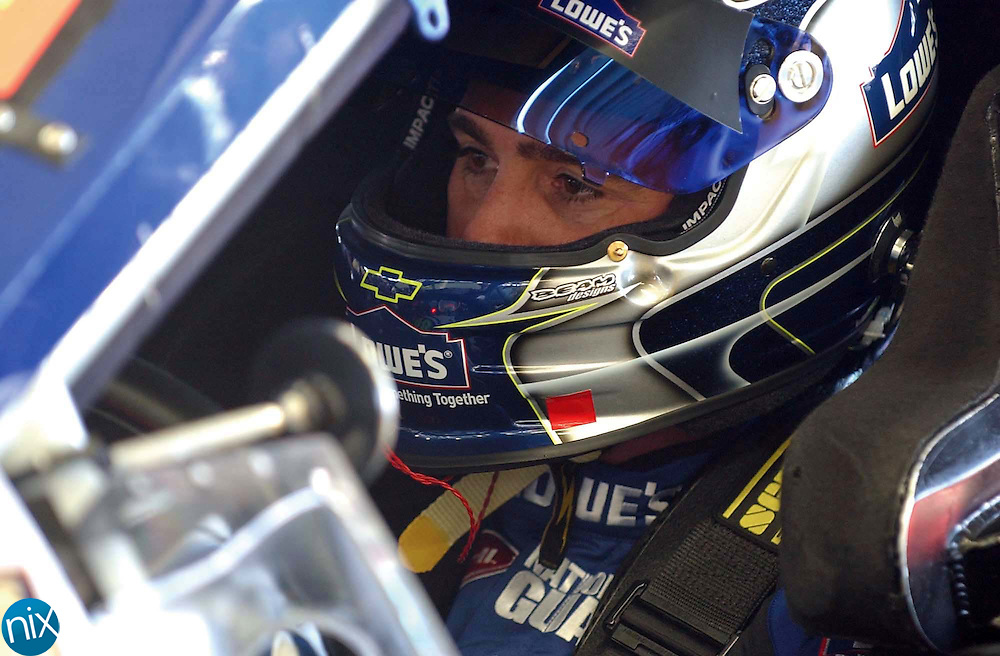Jimmie Johnson sits in his Nationwide Series car in the garage after going around the track for practice at Lowe's Motor Speedway, Thursday, May 22, 2008.        (photo by Bridgett Baker)