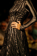 A model presents a creation by Indian designers Gauri and Nainika during the India Fashion Week in New Delhi, India, Saturday, April 8, 2006. (AP Photo/Sebastian John)