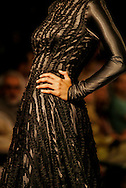 A model presents a creation by Indian designers Gauri and Nainika during the India Fashion Week in New Delhi, India, Saturday, April 8, 2006. (AP Photo/Sebastian John)
