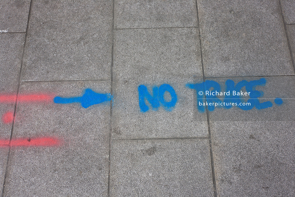 The words No Trace has been sprayed in aerosol on a London pavement.