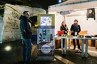 POMIGLIANO D'ARCO, ITALY - 6 MARCH 2018: A Five Star Movement donation machine is seen here next to a gazebo during the celebration event for Luigi Di Maio, leader of the Five Star Movement who returned to his his hometown to celebrate the movement's victory in the 2018 Italian General Elections, in Pomigliano D'Arco, Italy, on March 6th 2018.<br /> <br /> The Five-Star Movement, became the first party in Italy, with 33 percent of the vote.