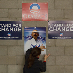 Jelena Hartman, 32, hangs signs for democratic presidential candidate, Sen. Barack Obama at Reno High School, a presidential caucus site in Reno, Saturday, Jan. 19, 2008...Photo by David Calvert/Bloomberg News