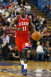 March 18, 2011; Sacramento, CA, USA;  Philadelphia 76ers point guard Jrue Holiday (11) dribbles the ball up court against the Sacramento Kings during the first quarter at the Power Balance Pavilion. Philadelphia defeated Sacramento 102-80.