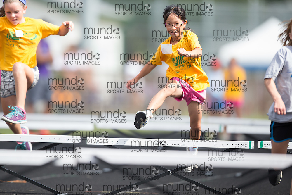 Athletes from St Thomas Legion Track and Field Club summer camp compete in the club's rugrats meet at Parkside Collegiate in St. Thomas, Ontario, August 5, 2015.<br /> Mundo Sport Images PHOTO/Geoff Robins