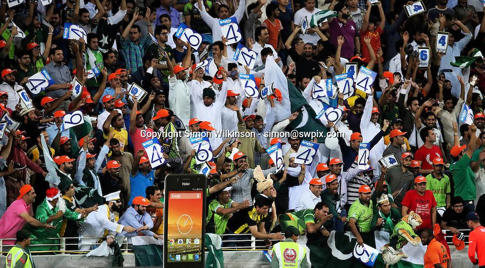 PICTURE BY MARK GREEN/SWPIX.COM  Pakistan v England 1st T20, Dubai Internayional Stadium, UAE, 26/11/15 <br /> Pakistan fans celebrating a 4