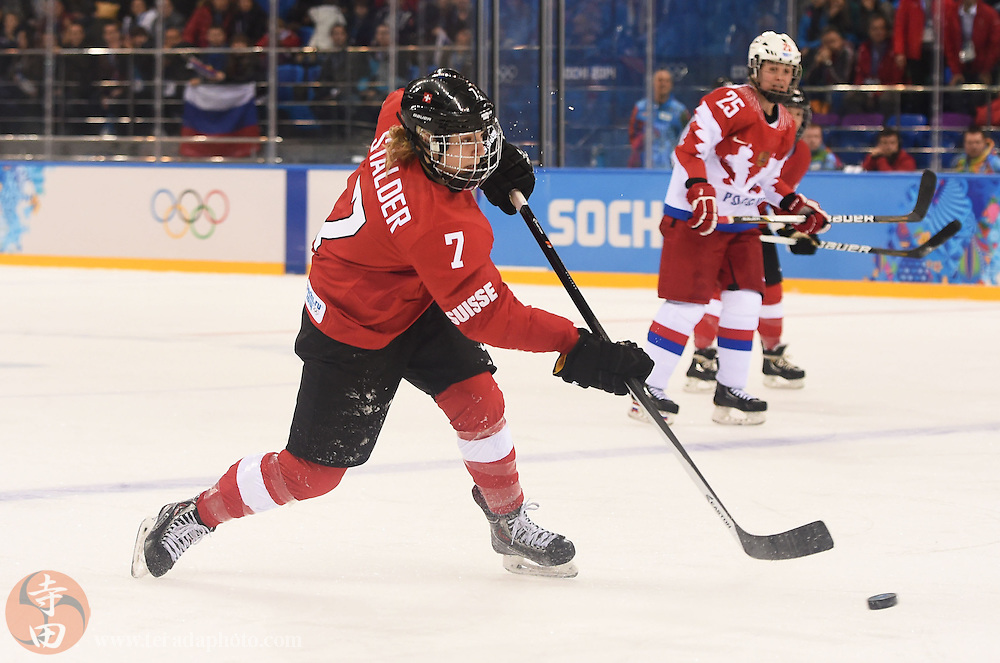Feb 15, 2014; Sochi, RUSSIA; Switzerland defenseman Lara Stalder (7) scores an empty net goal in a women's quarterfinals ice hockey game during the Sochi 2014 Olympic Winter Games at Shayba Arena.