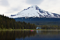 A red boat on peaceful Trillium Lake in the shadow of Mt Hood