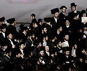 Followers of Aaron Teitelbaum congregate in a temporary tent synagogue for the shabbath, in Williamsburg, Brooklyn on April 28, 2006. The tent was erected as a show of power against Aaron?s brother Zelman. When their father, Satmar Rebbe Moshe Teitelbaum died on April 24th 2006, a long argument between his sons Aaron, 58, and Zalman, 54, escalated. The topic of the argument: Who is the rightfully heir to the Grand Rebbe title. Aaron and Zalman and their two congregations continue to fight a bitter conflict, in and out of the court system. Jewish immigrants began populating the neighborhood already in the early 20s. By 1983, an estimated 85 percent of the residents were jewish, with a change from irish, italian and modern jewish to orthodox hasidic jewish families.
