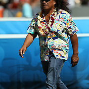 Hawaii performing legend, Henry Kapono, departs the NFL Pro Bowl stage after his pre-game performance.  Photo by Barry Markowitz