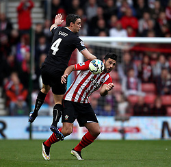 Burnley's Michael Duff and Southampton's Graziano Pelle - Photo mandatory by-line: Robbie Stephenson/JMP - Mobile: 07966 386802 - 21/03/2015 - SPORT - Football - Southampton - ST Marys Stadium - Southampton v Burnley - Barclays Premier League