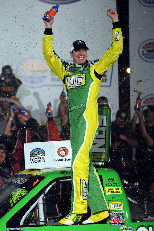 Camping World Truck Series driver Kyle Busch (18) celebrates in victory lane following his win in the North Carolina Education Lottery 200 at Charlotte Motor Speedway in Concord, NC.