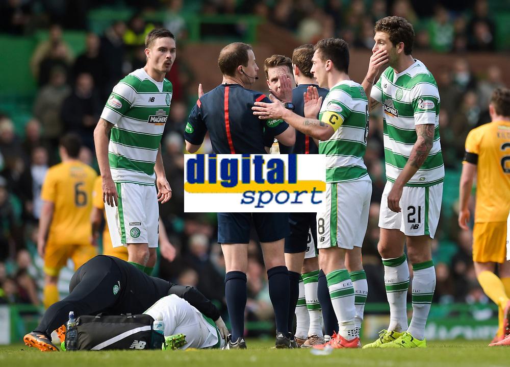 06/03/16 WILLIAM HILL SCOTTISH CUP QUARTER-FINAL<br /> CELTIC v MORTON<br /> CELTIC PARK - GLASGOW<br /> The Celtic players speak to referee Willie Collum (3rd from left) as Stefan Johansen (grounded) lies injured