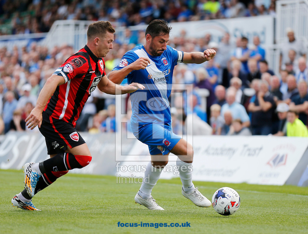 Billy Paynter (r) of Hartlepool United and Shaun Beeley of Morecambe during the Sky Bet League 2 match at Victoria Park, Hartlepool<br /> Picture by Simon Moore/Focus Images Ltd 07807 671782<br /> 08/08/2015
