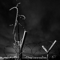 Barbed wire fencing in Woolwich, over looking the river Thames, in London England
