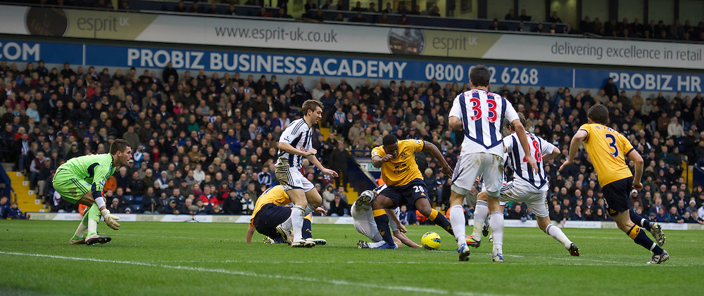 WEST BROMWICH, ENGLAND - Sunday, January 1, 2011: Everton's Victor Anichebe scores the first goal against West Bromwich Albion during the Premiership match at the Hawthorns. (Pic by David Rawcliffe/Propaganda)