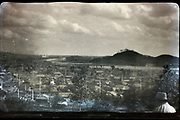 romantic panoramic landscape view of a city with a big river and hills in the background Japan ca 1940s