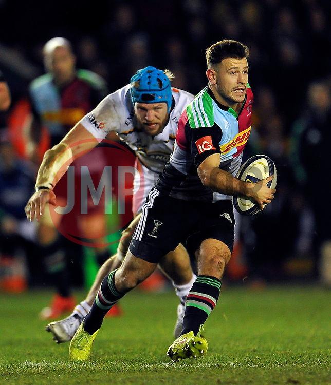 Danny Care of Harlequins takes on the Wasps defence - Photo mandatory by-line: Patrick Khachfe/JMP - Mobile: 07966 386802 17/01/2015 - SPORT - RUGBY UNION - London - The Twickenham Stoop - Harlequins v Wasps - European Rugby Champions Cup