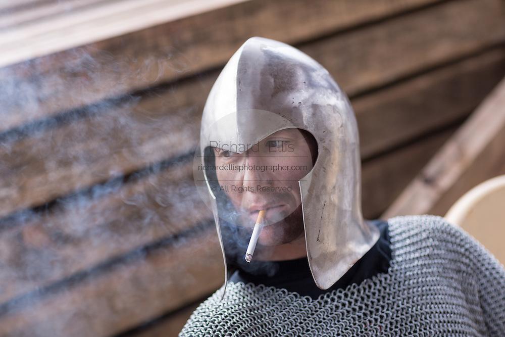Blacksmith Frank Verga wearing a medieval helmet he made in his metal working shop in Charleston, SC