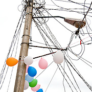 Chaotic tangle of power lines and balloons in Zihuatanejo, Mexico
