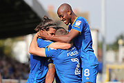 AFC Wimbledon midfielder Jimmy Abdou (8) celebrating with AFC Wimbledon defender Barry Fuller (2) and AFC Wimbledon defender George Francomb (7) after AFC Wimbledon striker Andy Barcham (17) (inside the huddle) scores during the EFL Sky Bet League 1 match between AFC Wimbledon and Doncaster Rovers at the Cherry Red Records Stadium, Kingston, England on 26 August 2017. Photo by Matthew Redman.