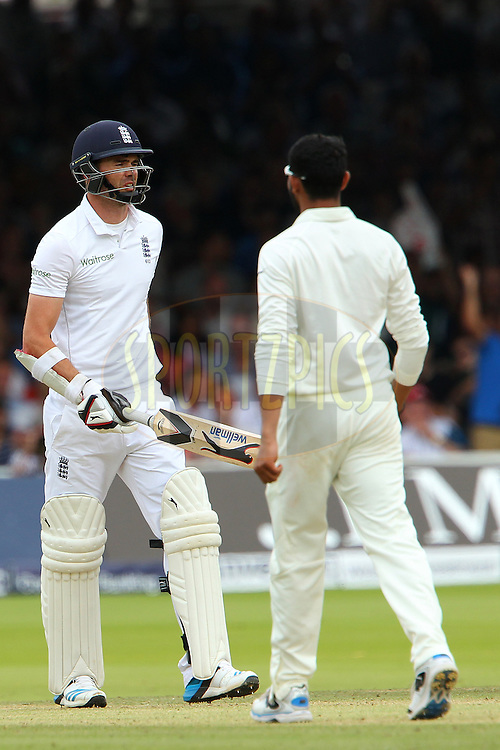 James Anderson of England departs after being dismissed by Ravindra Jadeja of India during day three of the 2nd Investec test match between England and India held at Lords cricket ground in London, England on the 19th July 2014<br /> <br /> Photo by Ron Gaunt / SPORTZPICS/ BCCI