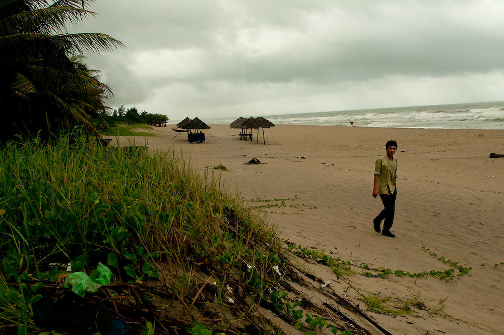 A storm rolls in on the beach in Hoi An, as talk of a coming hurricane keeps the locals inside.  (Laura Fong Torchia/Special to the Akron Beacon Journal)