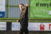 Forest Green Rovers manager, Mark Cooper acknowledges the supporters at the end of the match during the Vanarama National League match between Forest Green Rovers and Guiseley  at the New Lawn, Forest Green, United Kingdom on 22 October 2016. Photo by Shane Healey.