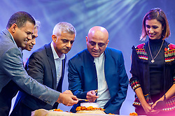 © Licensed to London News Pictures. 16/10/2016. London, UK. VIPs light the official candles opening ceremony of the annual Diwali taking place in Trafalgar Square.  (L to R) Rajesh Agrawal, Deputy Mayor for Business, Sadiq Khan, Mayor of London, Sruti Dharma Das, Temple President of Bhaktivedanta Manor, and Anita Rani BBC TV presenter.  Photo credit : Stephen Chung/LNP