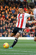 Brentford defender Nico Yennaris (8) has a shot on goal during the EFL Sky Bet Championship match between Brentford and Birmingham City at Griffin Park, London, England on 26 November 2016. Photo by Andy Walter.