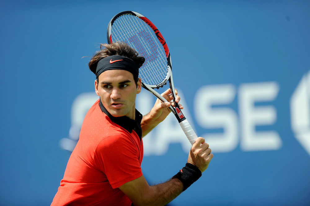 NEW YORK - AUGUST 31: Roger Federer returns a shot back to Devin Britton during day one of the 2009 U.S. Open at the USTA Billie Jean King National Tennis Center on August 31, 2009 in Flushing neighborhood of the Queens borough of New York City. (Photo by Rob Tringali) *** Local Caption *** Roger Federer