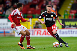 Bristol City Defender Nicky Shorey (ENG) is challenged by Swindon Forward Nicky Ajose (ENG) during the second half of the match - Photo mandatory by-line: Rogan Thomson/JMP - Tel: 07966 386802 - 21/09/2013 - SPORT - FOOTBALL - County Ground, Swindon - Swindon Town v Bristol City - Sky Bet League 1.