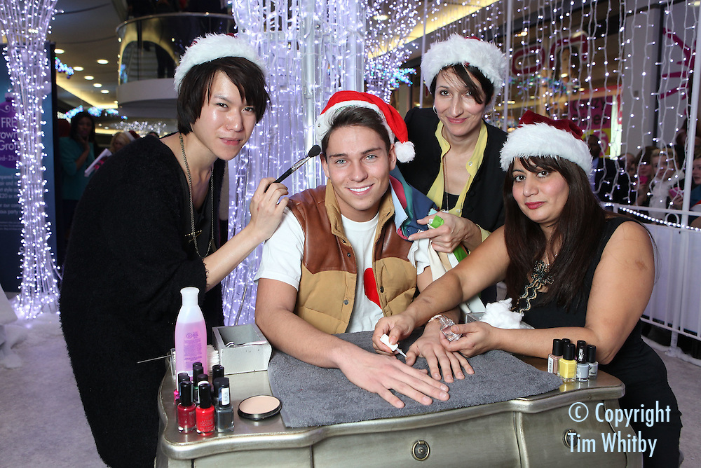 CROYDON, ENGLAND - DECEMBER 03:  Joey Essex gets treatments at the launch of the grown-up Grotto in Centrale Shopping Centre on December 3, 2011 in Croydon, England.  Shoppers who spend £20 in Centrale get a free treatment in the grotto which is open until 23 December 2011.  (Photo by Tim Whitby/Getty Images)