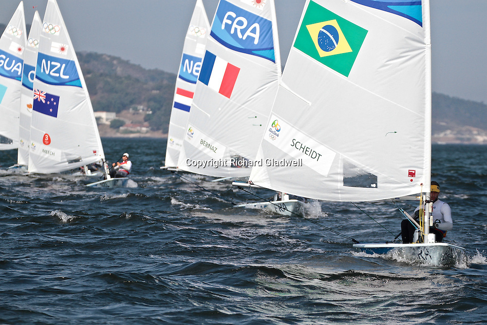 Robert Scheidt (BRA) leads the fleet home in the Medal Race - Mens Laser - 2016 Sailing Olympics.<br /> 16 August 2016.<br /> Copyright photo: Richard Gladwell / www.photosport.nz