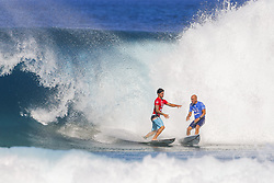 December 18, 2017 - Oahu, Hawaii, U.S. - 2014 World Champion and title contender Gabriel Medina of Brasil used his priority over 11X World Champion and multiple Pipe Master Kelly Slater of the USA in their Round Five Heat 3 battle at the 2017 Billabong Pipe Masters at Pipe, Hawaii, USA...Billabong Pipe Masters 2017, Hawaii, USA - 18 Dec 2017 (Credit Image: © WSL via ZUMA Wire/ZUMAPRESS.com)