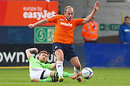 Jake Howells of Luton Town is tackled by Matt Taylor of Forest Green Rovers during the Skrill Conference Premier match at Kenilworth Road, Luton<br /> Picture by David Horn/Focus Images Ltd +44 7545 970036<br /> 21/04/2014