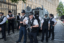 © Licensed to London News Pictures. 22/06/2017. London, UK. Armed police surrround a police van as colleagues remove a man who earlier was tasered near an entrance to Parliament. Photo credit: Peter Macdiarmid/LNP