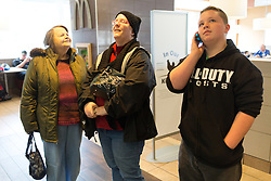1/27/15 11:47:33 AM -- Louisa, KY, U.S.A  -- Cheryl Castle, center, waits in line with her mother Alice Ratliff, left, and Nate, her son at McDonalds on Tuesday. Before the NeuroPace device was implanted into her skull Cheryl would not go into public places for the fear she would have a seizure. She is a recent recipient of the high-tech device, can now do many tasks she was unable to do when her epileptic seizures became more severe and more frequent. Now she's getting back to a normal life.<br /> <br />  --    Photo by Jonathan Palmer, Freelance