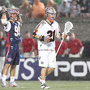 Ethan Vedder #21 of the Denver Outlaws and Paul Rabil #99 of the Boston Cannons are seen during the game at Harvard Stadium on May 10, 2014 in Boston, Massachusetts. (Photo by Elan Kawesch)