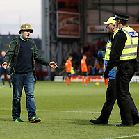 Dundee United v St Johnstone....21.11.15  SPFL,  Tannadice, Dundee<br /> A stupid saints fan runs onto the pitch after Chris Kane scored and was removed by police and stewards<br /> Picture by Graeme Hart.<br /> Copyright Perthshire Picture Agency<br /> Tel: 01738 623350  Mobile: 07990 594431