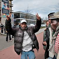 Nederland, Amsterdam , 16 april 2015.<br /> Illegalen in hun tijdelijk nieuwe onderkomen op de Jan Tooropstraat.<br /> Op de foto: Illegalen vertrekken vanuit de Jan Tooropstraat naar Den Haag om daar te gaan demonstreren.<br /> De eigenaar van het pand dat woensdag is gekraakt voor de uitgeprocedeerde asielzoekers in Amsterdam-West heeft hiervan donderdag aangifte gedaan. Dat liet een woordvoerder van de gemeente weten.&nbsp;<br /> Illegal immigrants in their temporary new home at  the Jan Tooropstraat in Amsterdam are on their way to The Hague to protest.