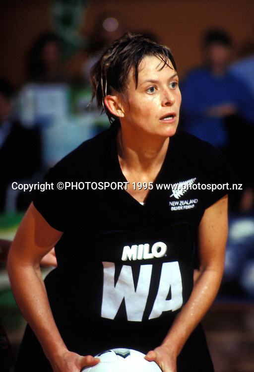 Silver Ferns captain Sandra Edge in action during the international netball match between New Zealand and England, 1995. Photo: Bruce Jarvis/PHOTOSPORT