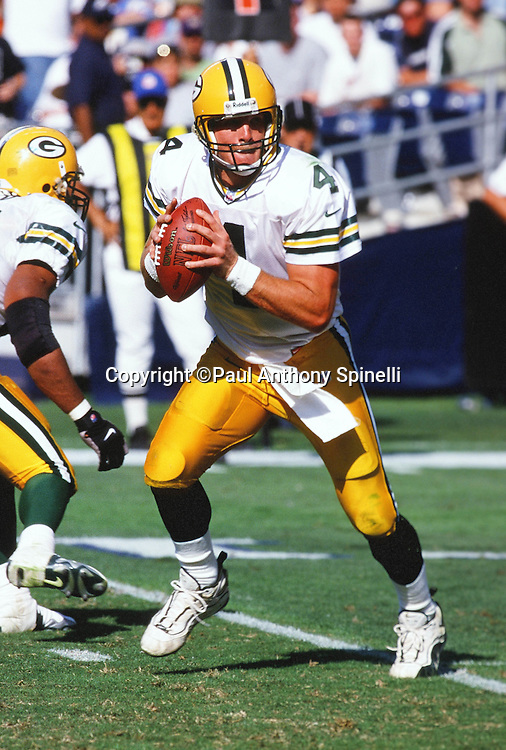 Green Bay Packers quarterback Brett Favre (4) drops back to pass during the NFL football game against the San Diego Chargers on Oct. 24, 1999 in San Diego. The Packers won the game 31-3. (©Paul Anthony Spinelli)