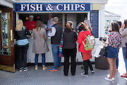 © Licensed to London News Pictures. 18/04/2014. Brighton, UK. People queue for fish and chips.  People enjoy the  bank holiday sunshine at Brighton today 18th April 2014. Photo credit : Stephen Simpson/LNP