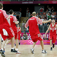 02 August 2012: Russia Vitaliy Fridzon celebrates at the end of 75-74 Team Russia victory over Team Brazil, during the men's basketball preliminary, at the Basketball Arena, in London, Great Britain.
