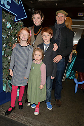 CAMILLA RUTHERFORD and DOMINIC BURNS with her children MAUD, NANCY & HECTOR  at the official opening of the 2014 Tiffany & Co.Christmas Shop on Bond Street, London on 16th November 2014.