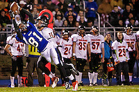 Coeur d'Alene High's Deon Watson stretches out while making a catch in mid-air a step in front of Marcus Colbert from Post Falls High during the first half of the Viking's 63-35 win Friday over the Trojans. Watson had seven catches for 140 yards and two touchdowns on the night.