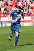Birmingham City defender, Paul Caddis (31) helping to clear the balls that the Charlton fans threw onto the pitch in protest during the Sky Bet Championship match between Charlton Athletic and Birmingham City at The Valley, London, England on 2 April 2016. Photo by Matthew Redman.