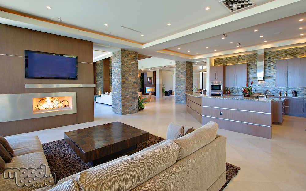 Open planned interior with furniture  a television and a kitchen