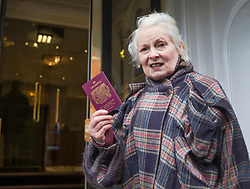 © Licensed to London News Pictures. 04/02/2016. London, UK. Dame Vivienne Westwood waves her passport as she arrives at the Ecuador embassy in London where WikiLeaks founder Julian Assange is currently living.  A United Nations panel is due to decide if Julian Assange has been kept in 'unlawful detention' during his stay at the embassy for the past three-and-a-half-years. Photo credit: Peter Macdiarmid/LNP